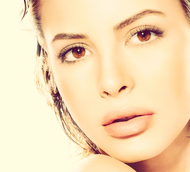 Use sugar and water.  In a gentle circular motion, work into the face or/and body.