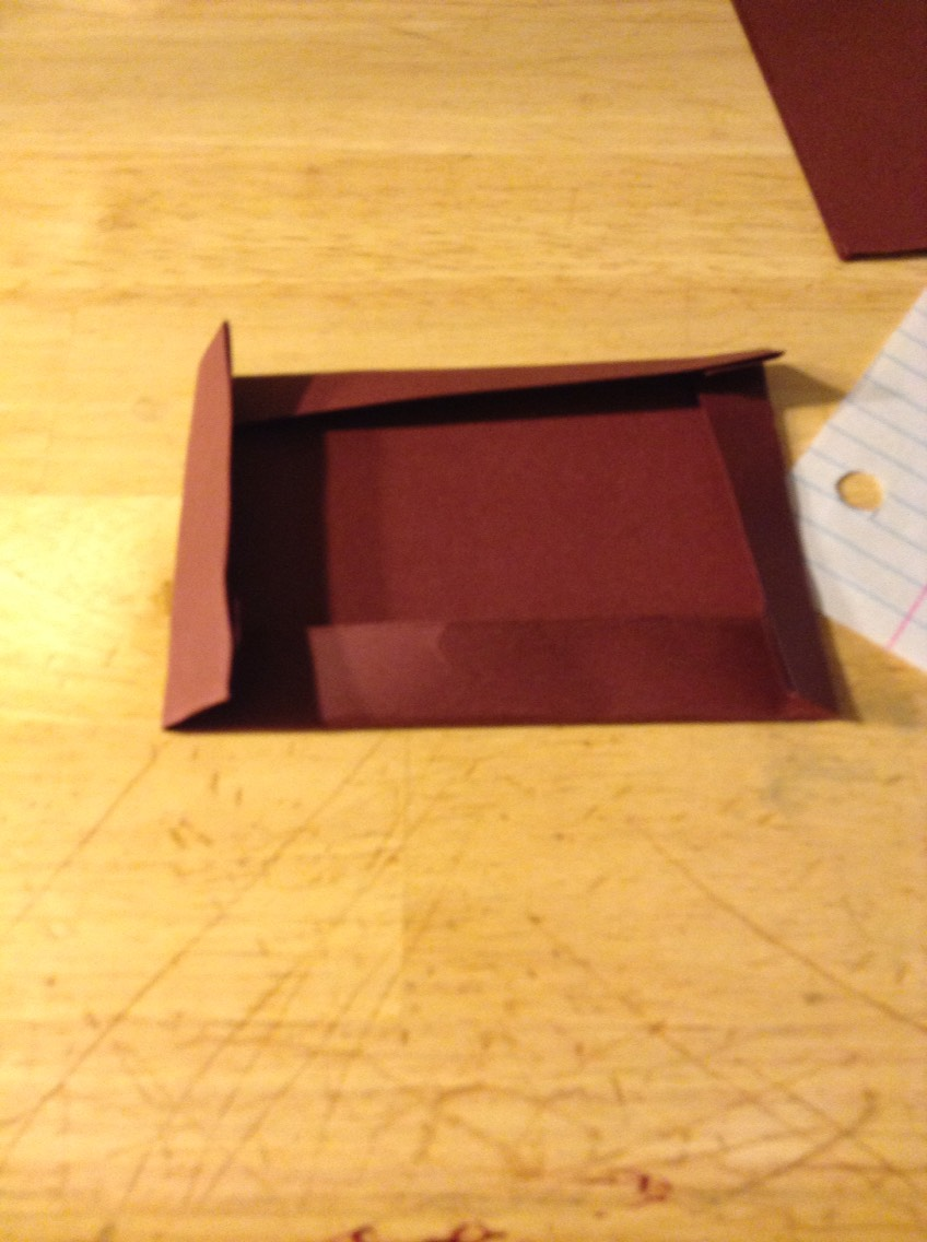 One square makes one box.   Take a square, and fold all the edges, as shown above.