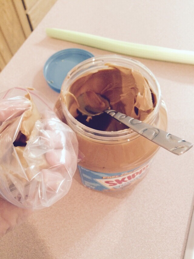 Put a few spoonfuls of peanut butter into your sandwich bag.