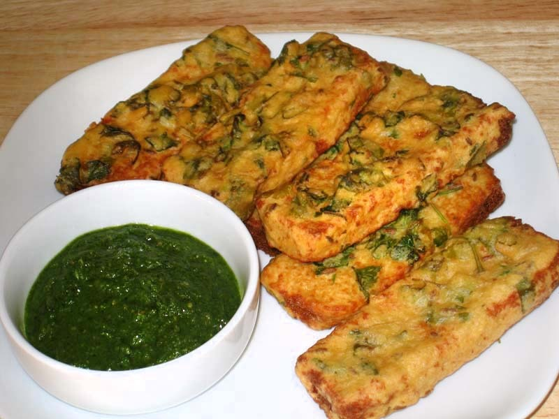 Cut bread in triangles , mix gram flour/ pea besan,with ground cumin ,chillie& garlic paste , onion, salt, coriander leaves. Add water batter should be consistent and thick .deep Fry in oil .. Enjoy with chai or black tea
