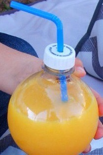 Poke a hole in bottle caps as a straw hole, to prevent spillage on your seats.