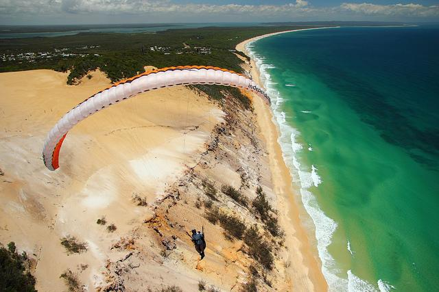 Rainbow Beach They say: more than 74 different colors of sand are coloring this beach, just like a rainbow! The colors came as a result of years of erosion and iron oxidation dating back to the Ice Age. This amazing beach is located in South-eastern Queensland, Australia.