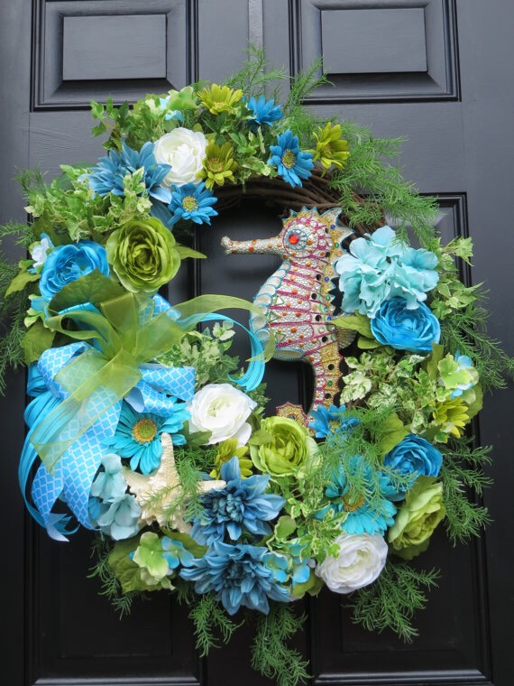 Flowers Try something different than a typical flower wreath! Hang a lightweight decorative pot or flower bucket with a bit of thick ribbon. Thisbucket-wreath from Etsy is upwards of $100, but you can certainly make your own!