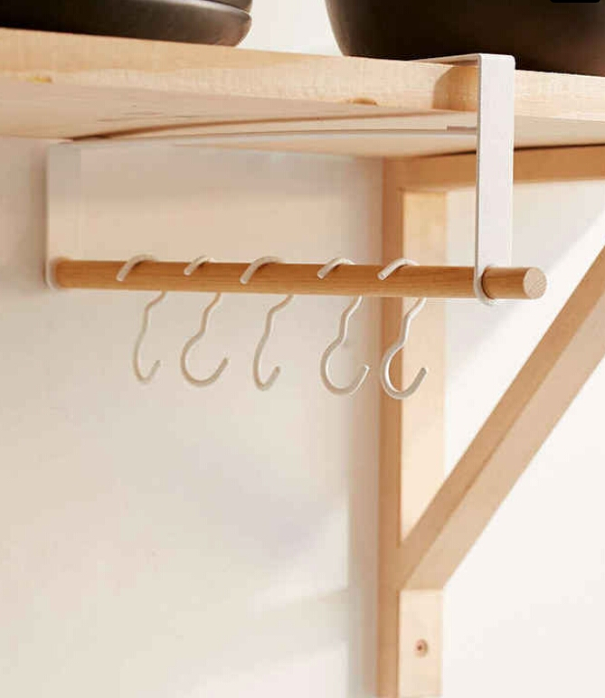 Under-shelf storage rack. For utensils, coats, or anything else. ($26)  http://www.urbanoutfitters.com/urban/catalog/productdetail.jsp?id=38624490&category=SEARCH+RESULTS