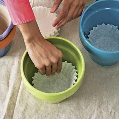 Stop soil from falling through the drainage hole in flowerpots by lining it with a coffee filter.