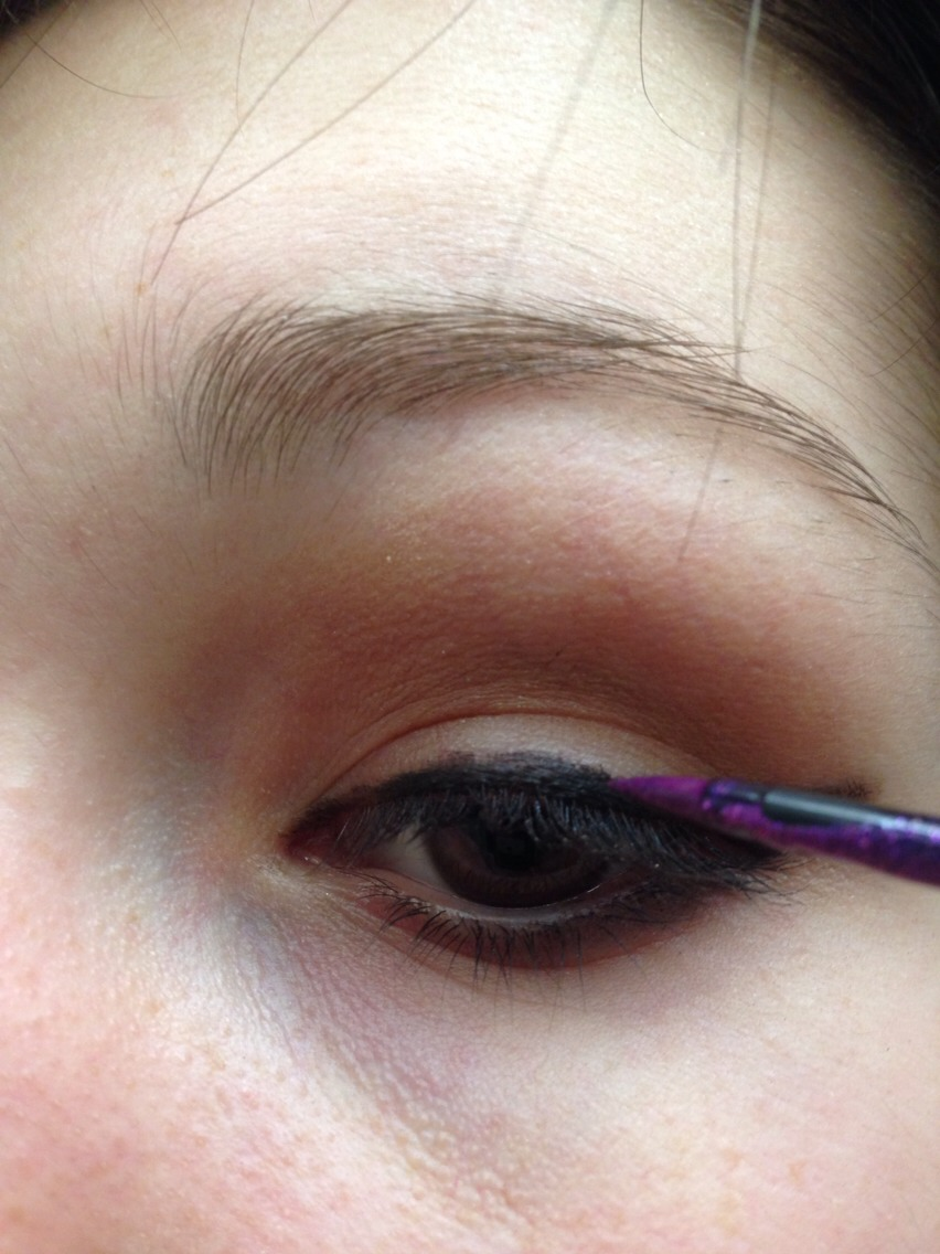 Now time for your subtle colour pop!  Use your colour liner and make a thin line over your initial cat eye flick.