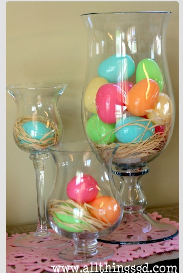 Simple. Place plastic eggs and hay in glass jars!   Gorgeous