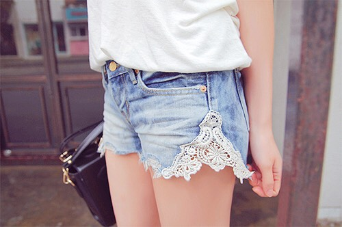 1. Lace Cut-Out Shorts Cut a triangle shape out of the side of an old pair of shorts, then measure your lace, and using a hot glue gun (or by sewing) attach the lace.