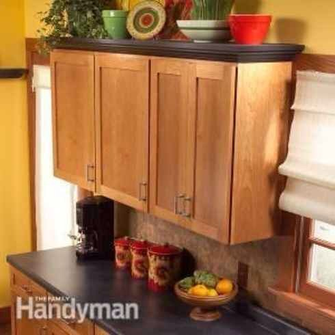 31. Add molding + shelving to the top of your kitchen cabinets.