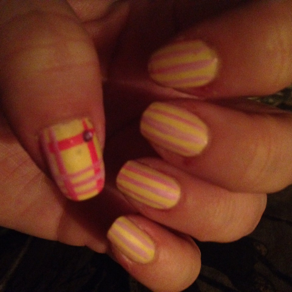 Pale yellow & pink stripes with plaid thumb