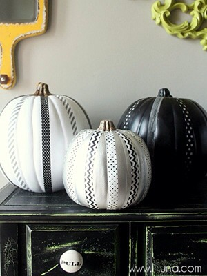 Use decorative tape and some paint to jazz up pumpkins and avoid the mess of carving
