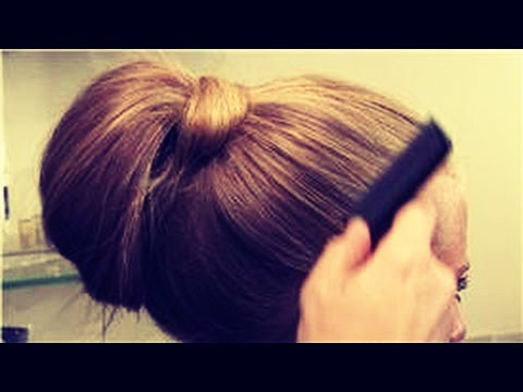 Section your bangs or any price of hair inn the front off.Put your hair into a ponytail and fold the hair in half and then add another hairtie. Take the section and wrap it around the ponytail type bun and pin it!