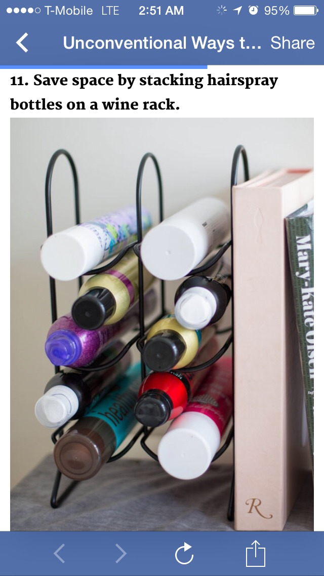 Save space by stacking hairspray bottles on a wine rack!