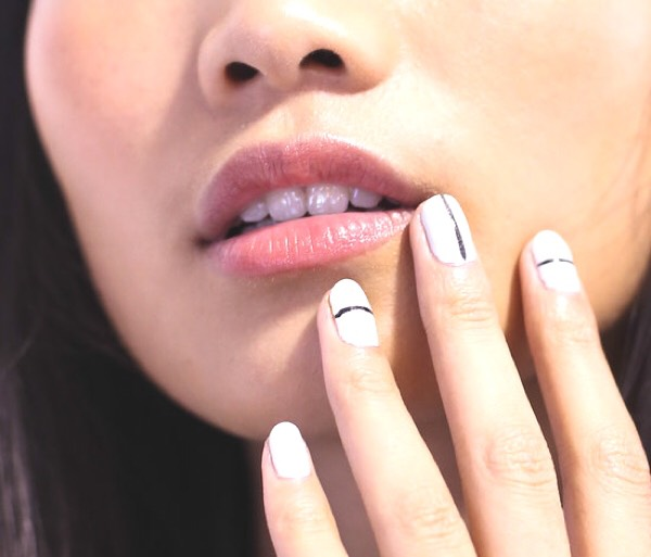 * Get a  cute modern look by painting a black line onto your nails. A black dot looks very chic as well.