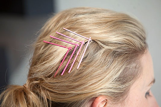 "11. Pin your bangs back with a cool ombré chevron bobby pin design. Start by pinning your bangs with one bobby pin with the open end pointed up. Complete the ""V"" shape by sliding one leg of another bobby pin at a downward angle inside the looped end of the first pin. Repeat as much as you wish."