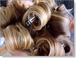 To make your curls last longer, wrap them up, and then pin them to your head and let them sit.