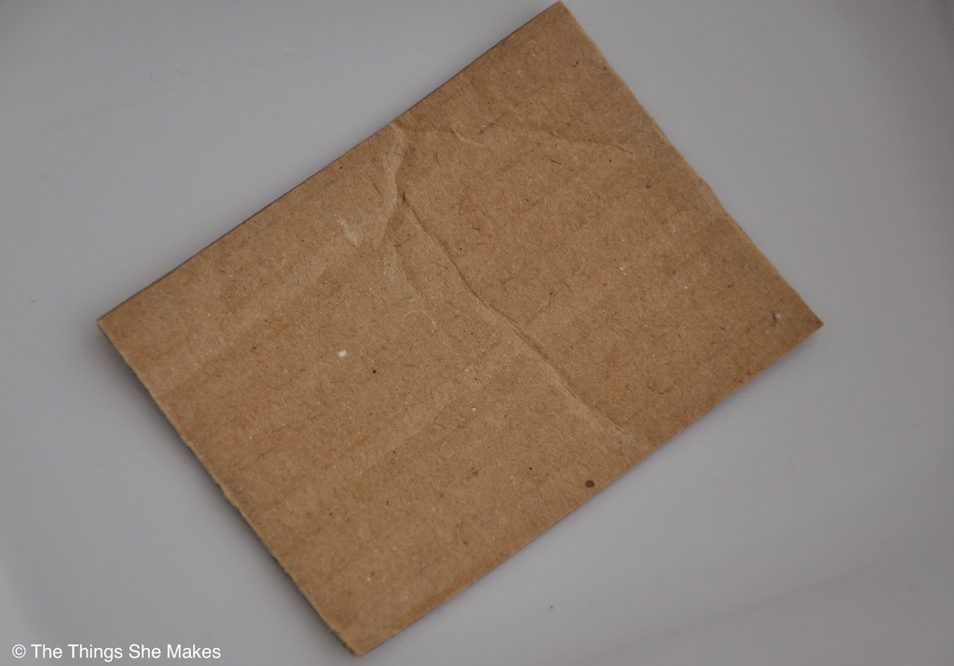 You will need a tiny square cardboard piece and put it inside of a...