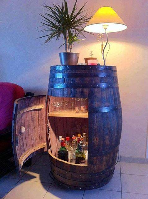 http://www.instructables.com/id/Convert-a-Wine-Barrel-into-a-Cabinet/