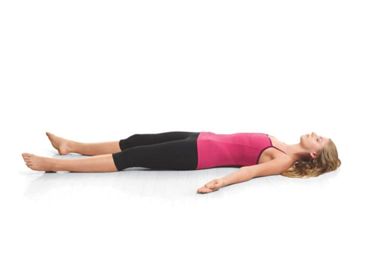 Corpse:Take a deep breath in. On your exhale, lie on the floor with your palms facing up and your eyes closed. Take a deep breath in through your nose and exhale from your mouth. Take two more deep breaths and just let your whole body relax onto the floor. Hold this pose for 2 minutes.
