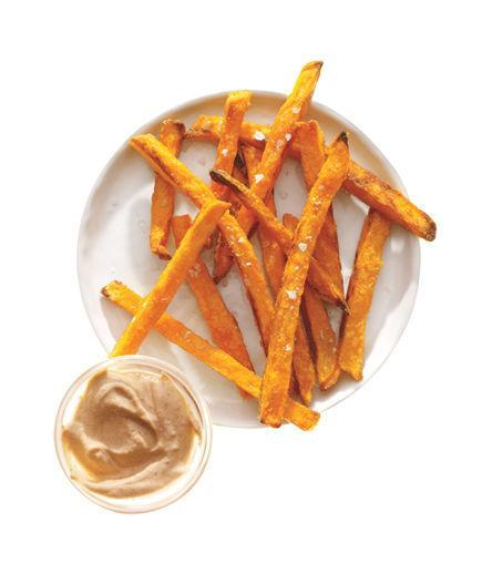 Sweet Potato Fries With Chipotle Yogurt  Cook 14 frozen sweet potato fries according to the package directions. Mix together 2 tablespoons plain low-fat yogurt and ½ teaspoon chipotles in adobo sauce and serve for dipping.  208 Calories   3g Fiber   3g Protein   10g Fat  