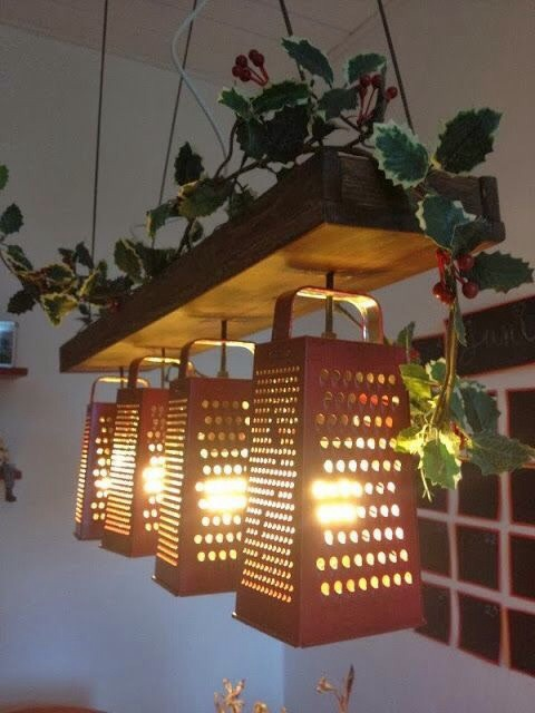 Use cheese graters as lamps/ to produce beautiful lighting effects. After wiring your lights, simply drill through the top of the grater.