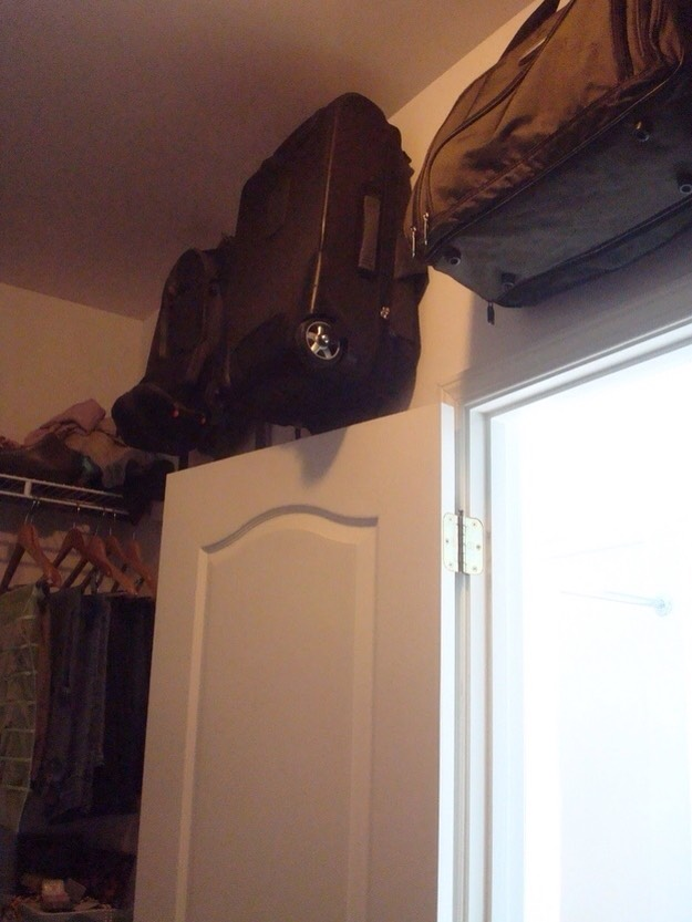 19. Hang suitcases in awkward spaces on hooks.