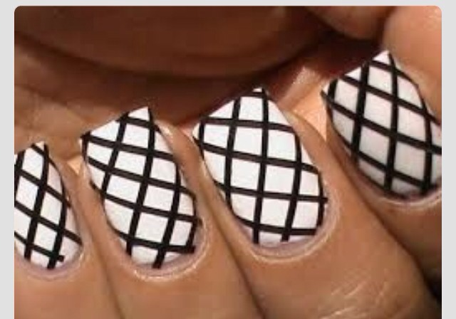 In this photo they used nail tapes, but using a striper brush is perfectly fine.