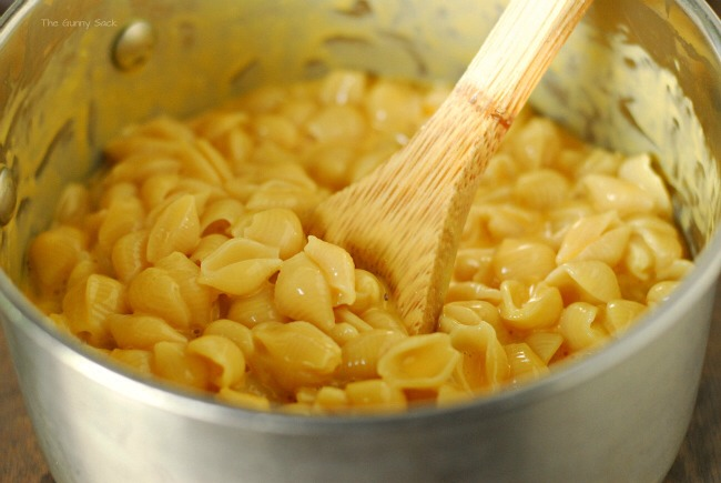 Start by making 3 cups of macaroni and cheese. I was in a hurry so I made a boxed version of macaroni shells and cheese instead of making the homemade version. Once box made 3 cups of mac n' cheese. Add 3 slices of American cheese and 1/4 cup of milk to make a little more cheese sauce.