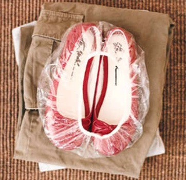 Pack your shoes in a shower cap to keep the soles from touching your clothes.