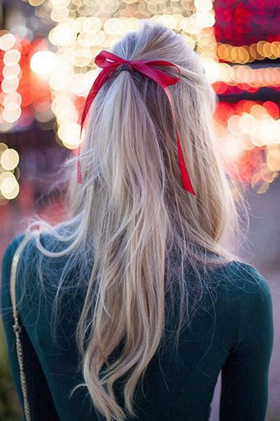 For a fun, cheeky look, secure a high half-up ponytail with a piece of ribbon.