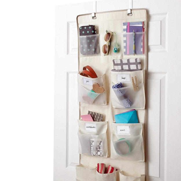 I have an organizer that hangs over my towel rack and holds my hair dryer, straightener, curling wand, and all of my brushes. Having everything tucked neatly nearby makes doing my hair in the morning SO much less frustrating.