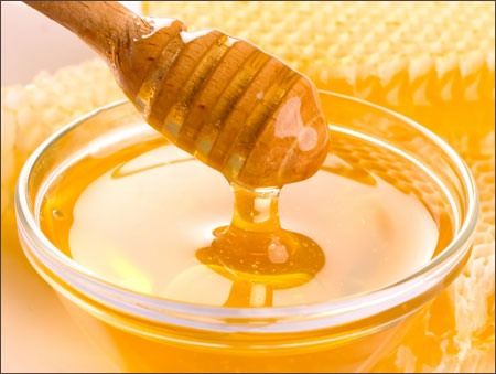 Pour your honey into your mashed strawberry and lemon mixture. Honey is a great natural moisturizer and it also has great anti-bacterial properties.