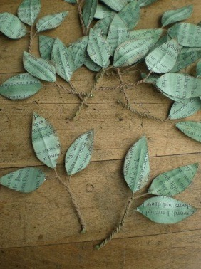 Cut leaf shapes out of an old book, use watercolor to get that green, and attach to wire, sticks, or anything else you can get a hold of!