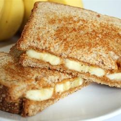 """A sweet, warm breakfast idea. Cooked like a grilled cheese, but filled with melted peanut butter and warm bananas."""