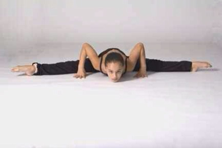 leaning very far forward in straddle almost middle splits.