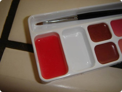 Mix the eyeshadow into a small amount of the Vaseline and apply to your lips!