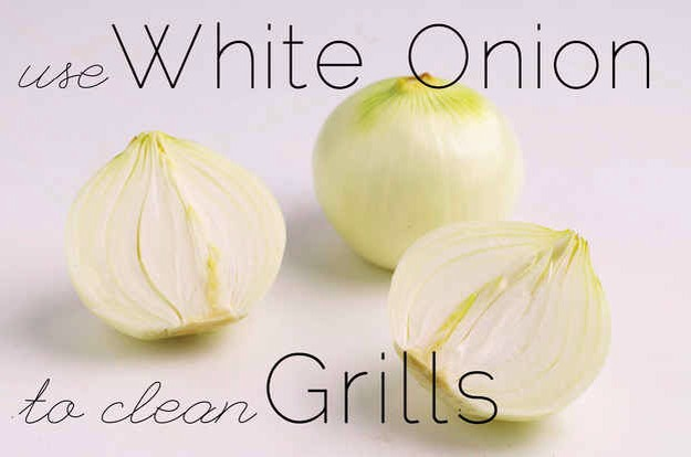 Rub half a white onion on a hot grill (using tongs for safety) to remove food buildup without chemicals