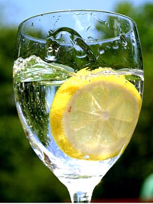 Instead of soda have water with lemon wedge or natural lemonade, lime and lemon are good source of vitamin C and kills your appetite!