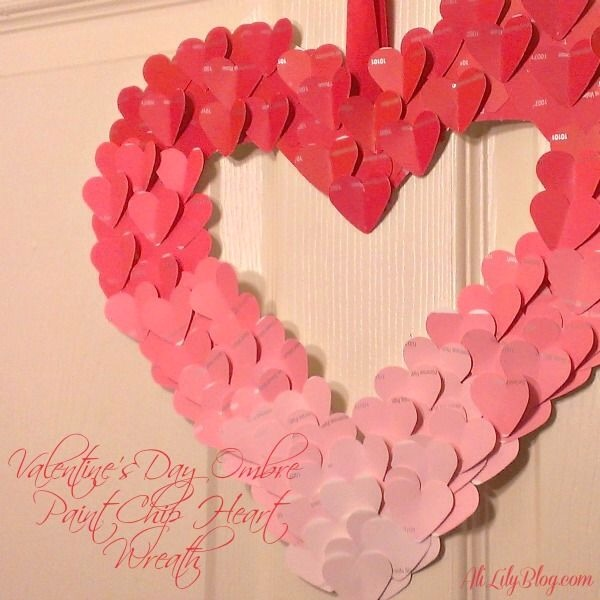 This was a super easy project!! All you need are a ton of paint chip samples, hot glue, ribbon and a wreath form. I actually cut out a heart from poster board and glue my hearts on to it. I used a heart paper punch to cut out the hearts. I then glued on the heart on to the heart cut out