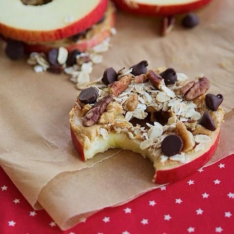 Take an apple slice and put some peanut butter on it, then coconut, walnuts and a few chocolate chips, or whatever kind of toppings you would like for a sweet but filling snack!