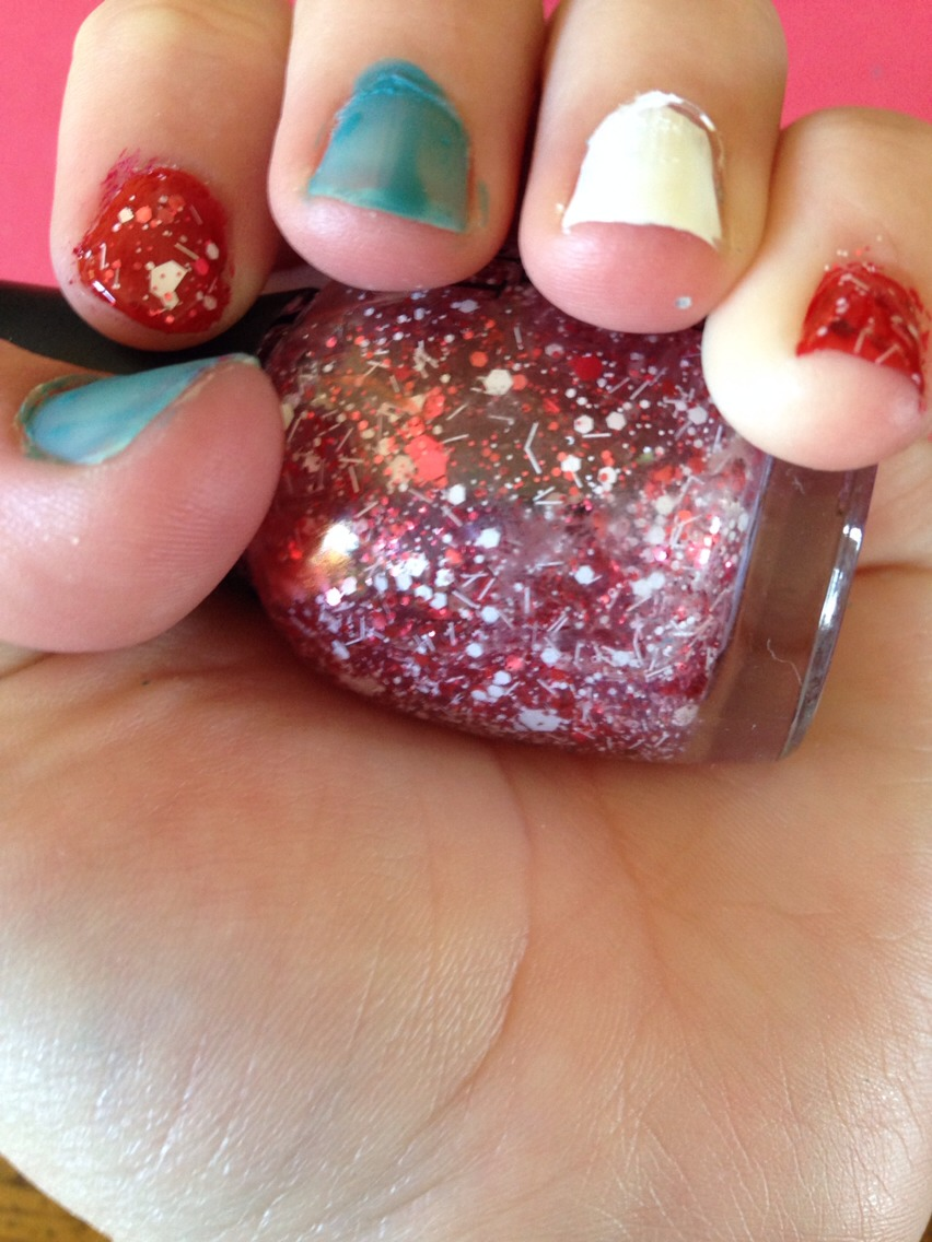 Paint red glitter on these two nails.