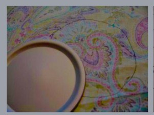 """2. Using the lid of the jar, trace around it on the wrong side of your fabric. Increase that circle's radius about 1"""" and cut out the larger circle."""