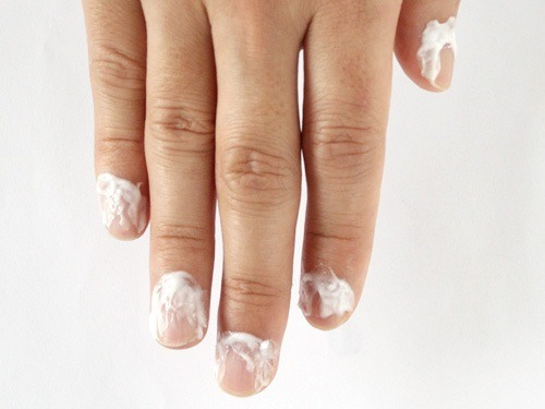 Dry your hands with a towel, and apply cuticle remover on your cuticles. How long you need to leave it on depends on the product, so follow the instructions of your remover.