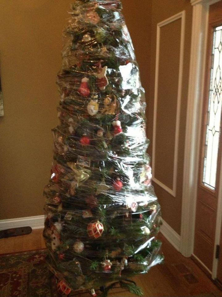 "Found this picture with the caption - ""Screw It! This Is How We Took Down Our Fake Christmas Tree This Year."" Kind of brilliant if you ask me. Wrap your already decorated fake tree in strong plastic and store upright in a closet or attic if possible."