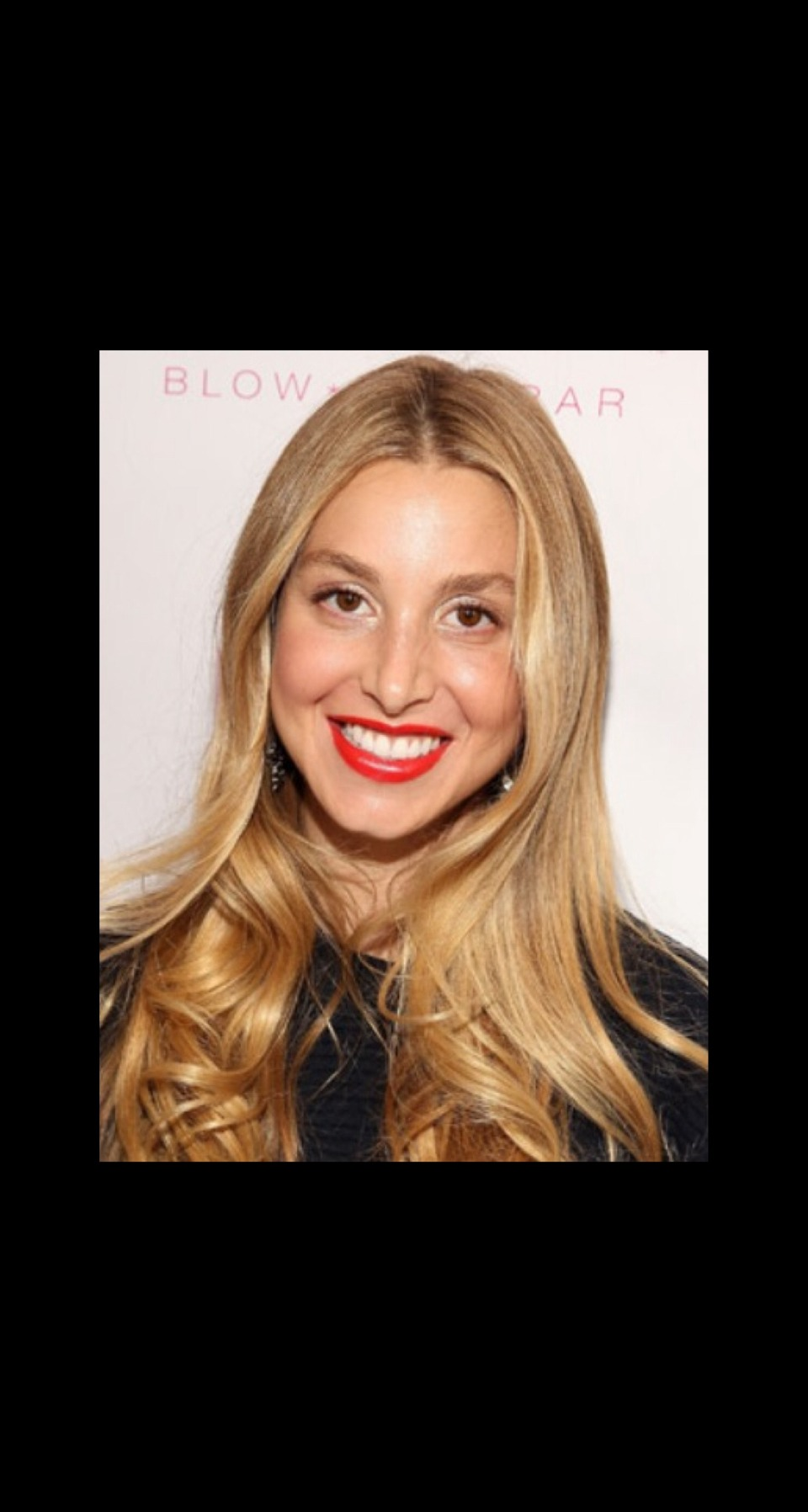 SURPRISE CURLS Whitney Port wore her super long hair mostly straight with curls at the bottom.