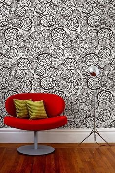 When you cut your wallpaper, cut the vertical strips 4 inches longer than the wall height. Sometimes the patterns don't line up perfectly and you'll need to move a strip up or down an inch so that it aligns. This way, you have wiggle room to line up any patterns correctly and can then trim away the
