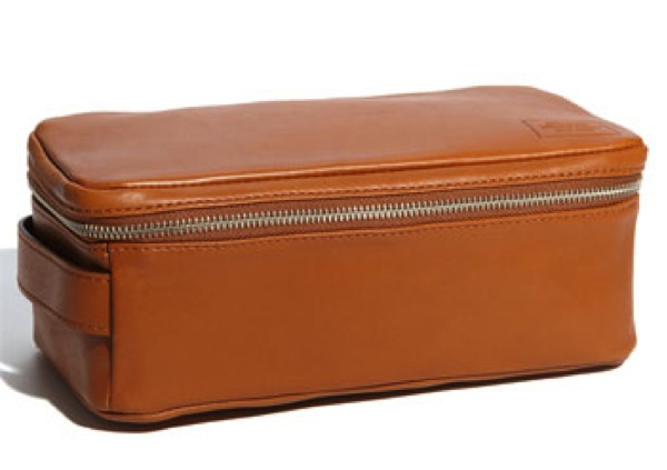 Send him away in style. Every man ought to have a nice dopp kit. I would get one that simple and classic with great storage!