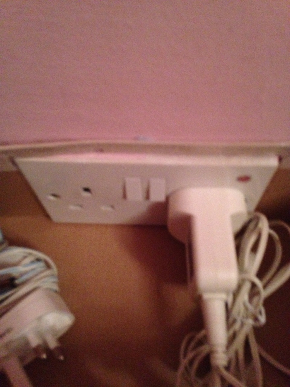 Measure out your plug point and cut out a square in the back of the box using those measurements.