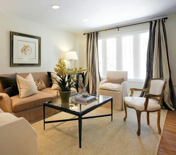 Easy Elegance Keep a formal living room from getting too fussy by mixing dramatic accents like these floor to ceiling drapes with everyday classics, like a pair of neutral slipper chairs.