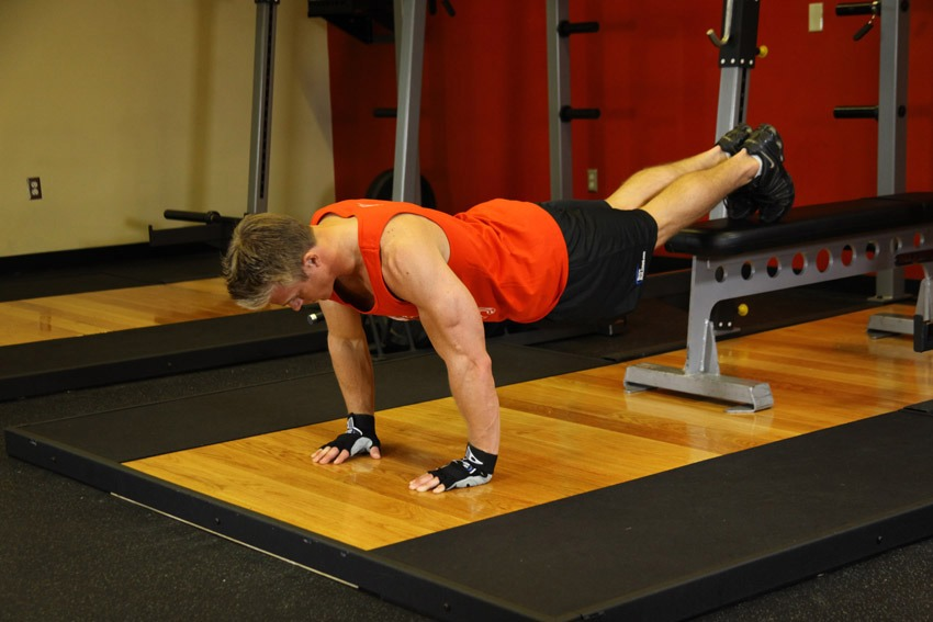 To feel the burn faster when doing push-ups elevate your feet to the height of your shoulders. It improves muscle growth in the pectoral muscles.